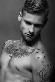 cool wing and skull tattoo on chest for men black and white tats