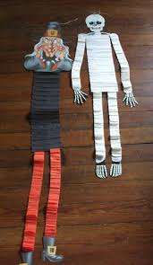 vintage halloween witch and skeleton cardboard decorations