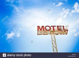 classic motel sign against blue sky stock photo royalty free