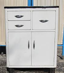 Vintage White Metal Cabinet With An Enamel Top Via Etsy Head - Enamel kitchen cabinets