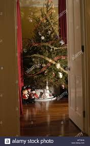 traditional christmas tree seen through doorway in victorian house
