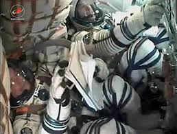 soyuz with olympic torch and crew of three docks with space