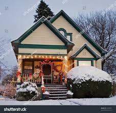 yellow victorian house green trim christmas stock photo 22186291