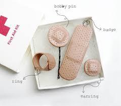 earring plasters aid kit jewellery set design and berries