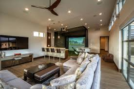 Home Golf Simulator by Custom Home Blends Natural Inspiration With Industrial Style