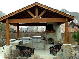 classic style of outdoor kitchen ideas installed under wooden