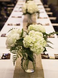 hydrangeas in mason jars on a burlap runner you could also add