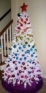white christmas tree with multicolor lights this year s holiday theme glitzy and glamorous dashes of drama