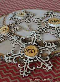 burned wood ornaments snowflakes and words