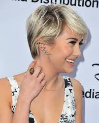 short mid hair pushed behind ears how to match your earrings to your hairstyle hair world magazine