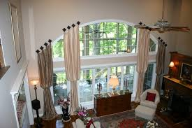 great extra long curtain window treatment for large arched window