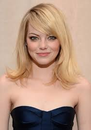 ladies hair styles with swept over fringe emma stone layered medium length hairstyle with side swept bangs