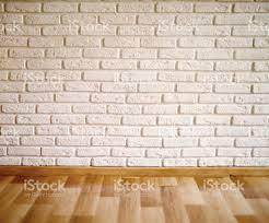 Wood Laminate Flooring On Walls Empty Room With Wood Laminate Floor And Brick Wall Stock Photo