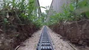 lego fan snakes intricate track out of his house and model