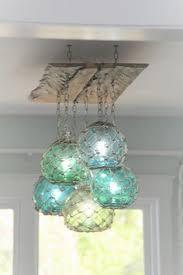 glass fishing float pendant light by karapaslay via flickr diy japanese glass fishing float light