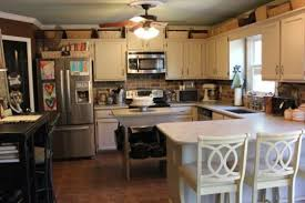 Area Above Kitchen Cabinets Decorating Above Kitchen Cabinets Interior Improvement 700 X 525