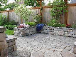 Patio Rock Ideas Stone Patio With Stone Planter Or Bench Around Perimeter Back