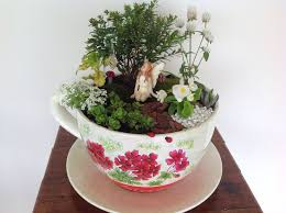 create your own charming fairy garden using an old teacup and