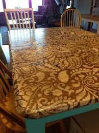 staining a table top paint a stencil on the raw wood then stain on top of it so doing