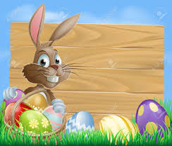 a cute easter bunny rabbit character standing by a wooden sign
