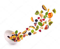 bowl of fruits fresh mixed fruits pieces falling in white bowl of fruit salad