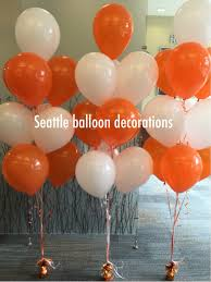 seattle balloon delivery white and orange balloon bouquet seattle balloon decorations
