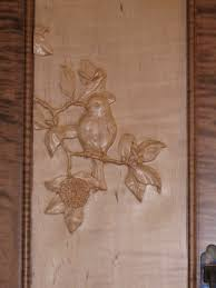 carved cabinet door panels spice cabinet close up of hand carved cabinet door panel bird in a