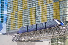 las vegas light rail a monorail train passes beside the multi colored facade of the