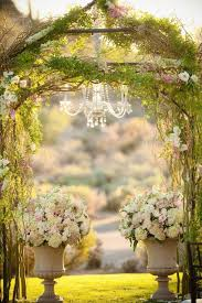 From A Chandelier Perfection A Chandelier Hanging From A Greenery Wrapped Altar
