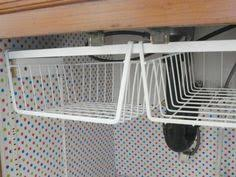 under cabinet hanging basket the low hanging bread basket shelves organizations and organizing