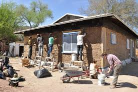 build homes nonprofit teaches communities how to build homes out of straw