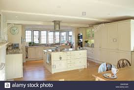 a large modern cream country kitchen in a home in the uk stock
