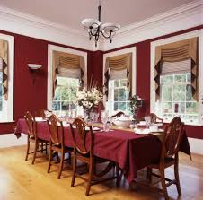 british dining room design in dark red walls and table cloth idea