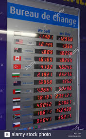 bureau de change display board showing rates of exchange stock photo