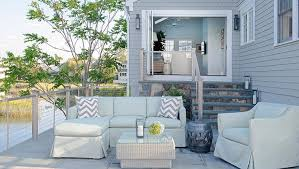 Deck Coffee Table - lakeside deck with slipcovered sectional and wicker coffee table