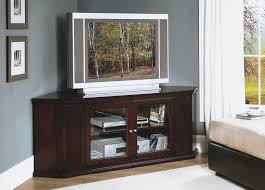 corner brown varnished wooden tv cabinet with glass door on