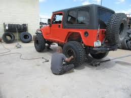 jeep shocks stabilizing a jeep wrangler coil spring control arm suspension to
