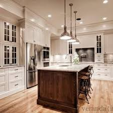 white kitchen cabinets with wood interior white granite countertops transitional kitchen