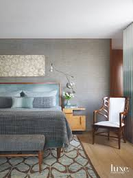 a new york apartment becomes a light filled home luxe interiors a custom teak framed bed by edward ferrell and lewis mittman in the master bedroom