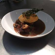 A Root Vegetable - blade of beef with chestnut mushrooms and a root vegetable mash