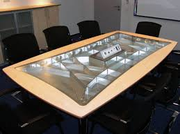 glass conference room table with wood founterior