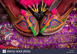 colorful ethnic shoes and camel decorations on violet rajasthan