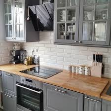 light grey kitchen cabinets with wood countertops pin by mike amato on kuchnie grey kitchen designs kitchen
