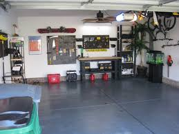 after garage makeover design and floor painted with black color