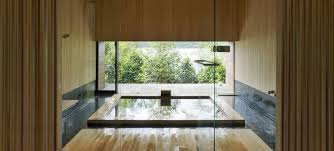 japanese bathroom design small space bathtub beside wastafel glass