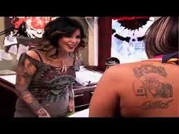 kat von d tattooing her portrait on her fan miami ink youtube