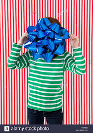 large gift bow studio of girl 4 5 holding large gift bow in front of
