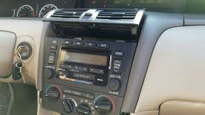 how to remove radio cd player from toyota avalon 2001 for repair