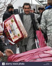 gifts workers unload warm blankets for the inmates at the zabul