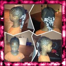 fancy cornrowed mohawk with braids and beads natural hair style